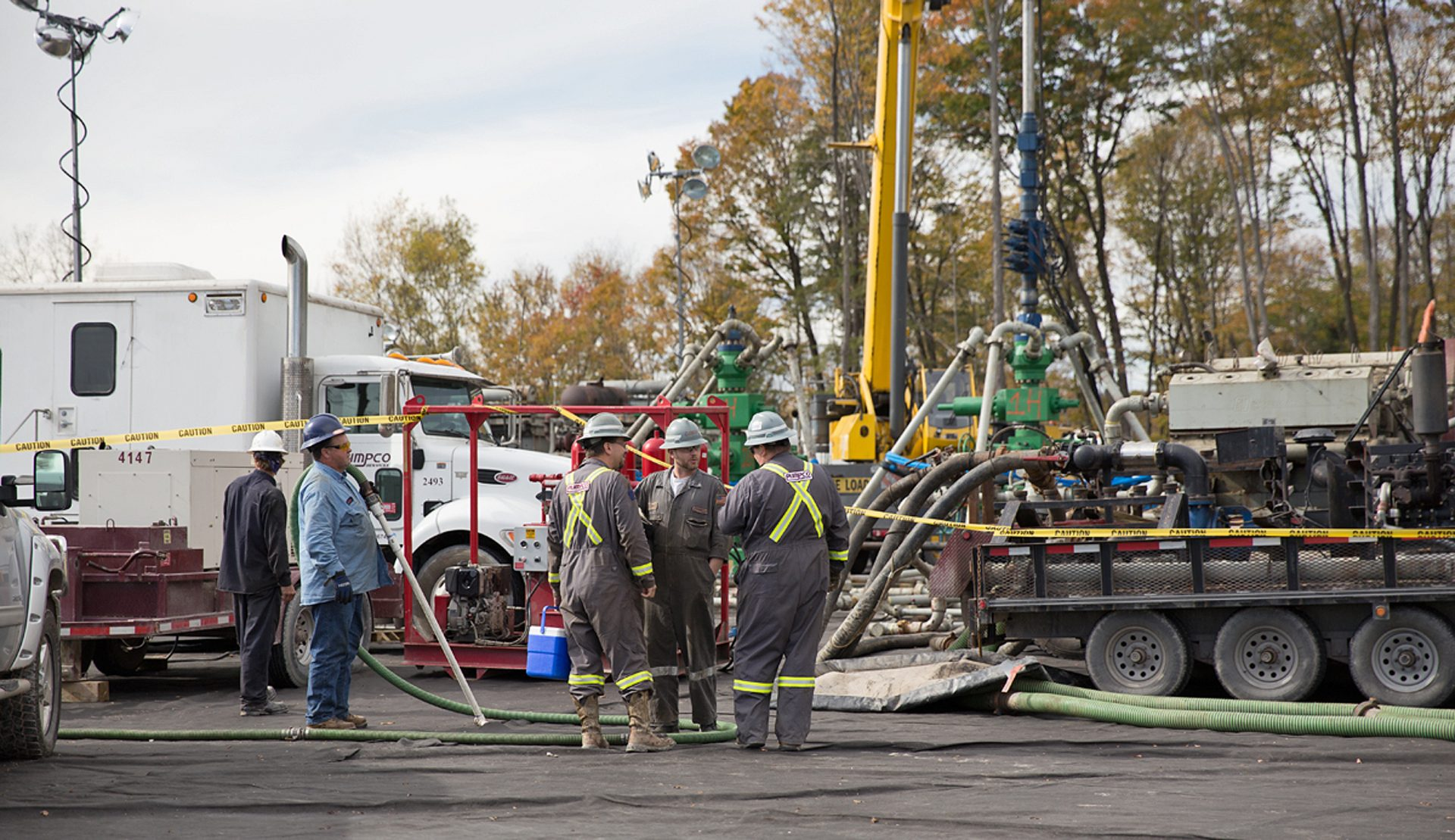 Workers vacuum fluids surrounding a frack site in Harford Township, Susquehanna County, Pa.