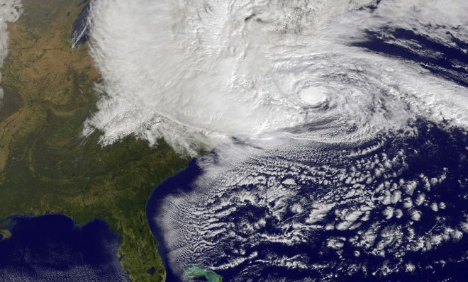 Scientists have been studying the link between climate change and extreme weather events such as Hurricane Sandy, shown here in a NASA image, which left more than 1.3 million Pennsylvanians in the dark in 2012.