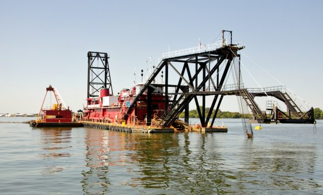 "The dredger named the ""Illinois"" uses its already lowered arm, 35 feet into the Delaware River, to suck out the sediment. The project went through an environmental assessment as part of the National Environmental Policy Act."