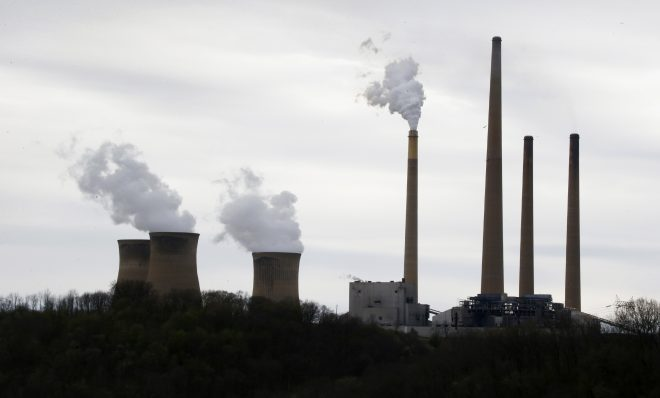 "This photo taken May 5, 2014 shows the stacks of the Homer City Generating Station in Homer City, Pa. Three years ago, the operators of one of the nation's dirtiest coal-fired power plants warned of ""immediate and devastating"" consequences from the Obama administration's push to clean up pollution from coal. Faced with cutting sulfur dioxide pollution blowing into downwind states by 80 percent in less than a year, lawyers for EME Homer City Generation L.P. sued the Environmental Protection Agency to block the rule, saying it would cause a painful spike in electricity bills and grave harm to power producers like itself."