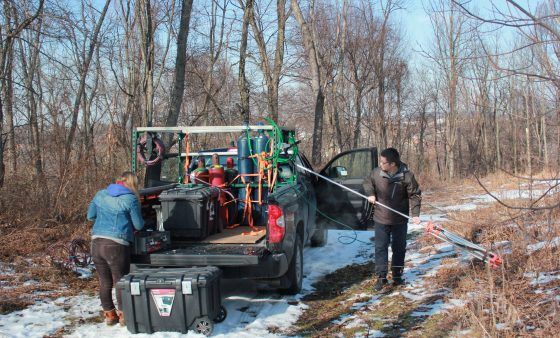 Researchers Xiang Lee and Melissa Sullivan prepare to measure methane from a well site in Monroeville Community Park.