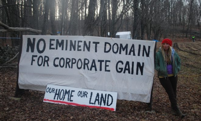 Megan Holleran stands by a sign on her family's land, March, 2016. The Hollerans lost their court battle to save their maple trees from eminent domain seizure. The trees were cut to make way for the Constitution Pipeline, which had been stalled amid legal battles until Williams withdrew the project in February.