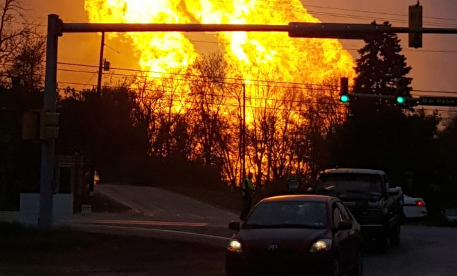 Flames erupt during a natural gas pipeline explosion in Greensburg, Pa. in 2016. The explosion, which burned one person, caused flames to shoot above nearby treetops in the largely rural Salem Township, about 30 miles east of Pittsburgh, and prompted authorities to evacuate businesses nearby.