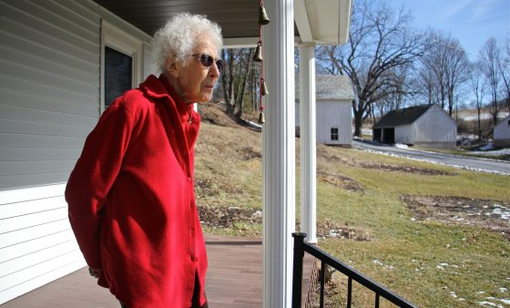From the porch of her Palmerton farmhouse, Albertine Anthony looks out on the rolling hills of lower Carbon County. She believes the PennEast pipeline's proposed route through her 124-acre farm threatens her water supply. (Emma Lee/WHYY)