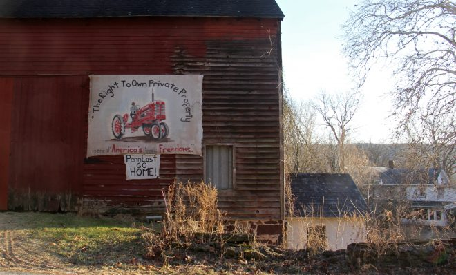 A sign on the side of a barn on Riegelsville Road in Holland Township, New Jersey, shows local opposition to the PennEast pipeline.
