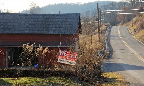 A sign on Riegelsville Road in Holland Township, New Jersey, shows local opposition to the PennEast pipeline. (Emma Lee/WHYY)