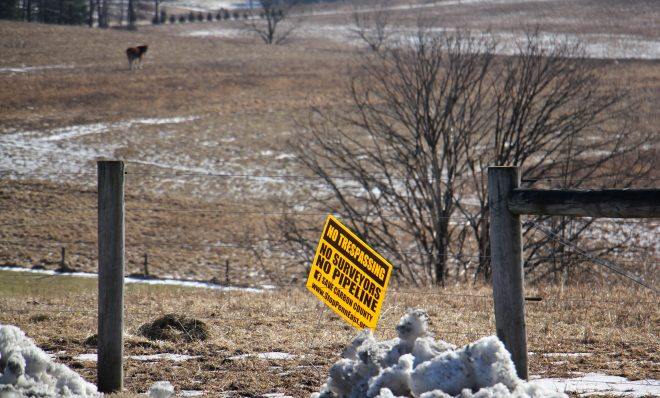 A sign on farmland in Palmerton shows local opposition to the PennEast pipleline. Some believe land under the Farmland Preservation program has been targeted for the route because of it's lower market value. (Emma Lee/WHYY)