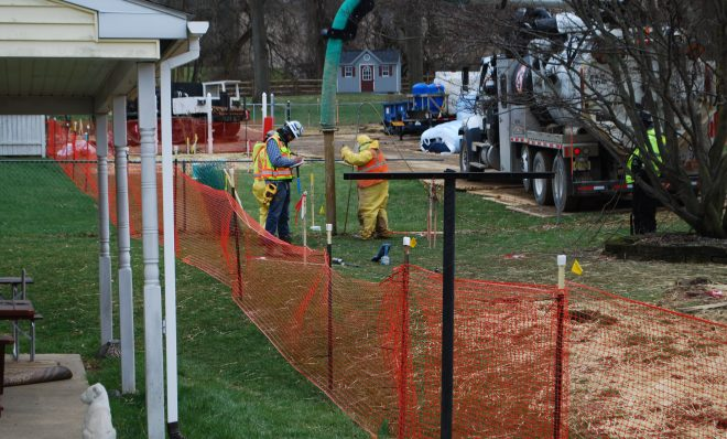 In this photo from May 2018, pipeline workers probe the ground on Lisa Drive in West Whiteland Township where sinkholes have developed as a result of the Mariner East 2 construction.