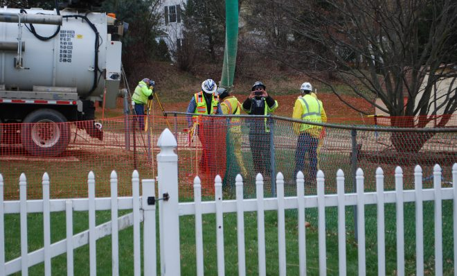 In this May 2018 photo, workers and contractors for Sunoco Pipeline investigate sink holes behind homes at Lisa Drive, West Whiteland Township, Chester County where the company has been drilling for construction of the Mariner East 2 and 2X pipelines. The company offered to relocate residents of the five homes whose yards are crossed by the pipeline right of way.