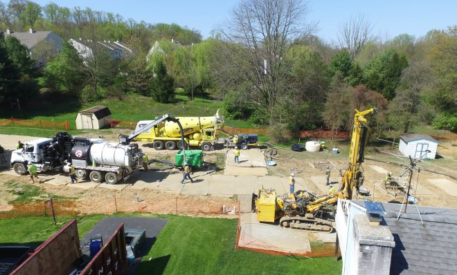 In this file photo, Mariner East 2 pipeline construction crews work in the backyards of homes on Lisa Drive in West Whiteland Township, Chester County, on May 2, 2018 after sinkholes opened in the area. That caused one of the ME2 project's many delays.