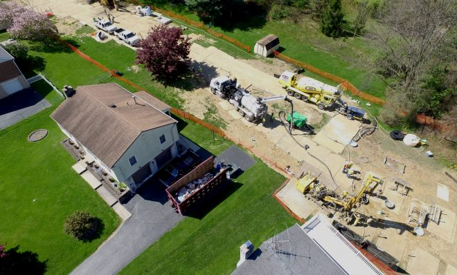 Mariner East 2 pipeline construction crews work in the backyards of homes on Lisa Drive in West Whiteland Township, Chester County, on May 2, 2018. Sinkholes that opened in the area prompted the state's Public Utility Commission to order that an existing pipeline nearby, the Mariner East 1, be shut down until it could be determined that the sinkholes didn't threaten its safety. PUC on May 3 approved a re-start of Mariner East 1.