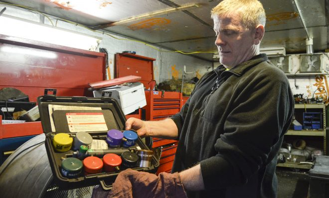 Scott Reynolds, owner of Express Transmission in Beaver County, shows an array of gas cap adapters. The adapters are used as a part of Pennsylvania's vehicle emission testing program.
