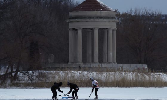 Youths play ice hockey on a frozen pond at Franklin Delano Roosevelt Park during a winter storm, Thursday, Jan. 4, 2018, in Philadelphia. (AP Photo/Matt Slocum)