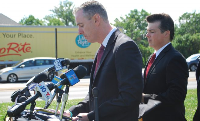 Pennsylvania Congressmen Brian Fitzpatrick, a Republican (left), and Brendan Boyle, a Democrat, urged EPA to set national regulation on PFAS chemicals. They spoke outside Horsham Air Guard Station in Bucks County, Pa. on June 25. Fitzpatrick called on EPA Administrator Scott Pruitt to resign in part because of his handling of a report on the toxic chemicals.