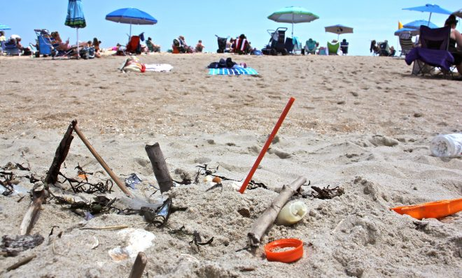 Plastic trash is deposited at the high tide line at Monmouth Beach, New Jersey. A new local law prohibiting merchants from using plastic straws, styrofoam food containers, and plastic bags is a small step in the right direction, supporters say.