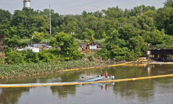 An environmental cleanup crew works to remove fuel from a spill in Darby Creek in Tinicum Township, Pennsylvania, near the Philadelphia International Airport.