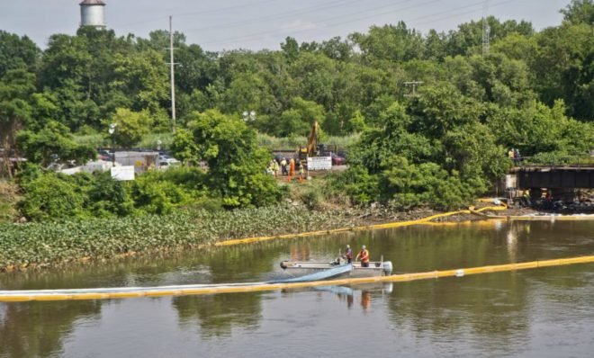 An environmental cleanup crew works to remove fuel from a spill in Darby Creek in Tinicum Township, Pennsylvania, near the Philadelphia International Airport. Sunoco plans to use this same line to ship natural gas liquids until construction along the Mariner East 2 is completed.