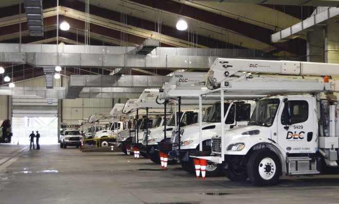 FILE PHOTO: Duquesne Light crews prepare their trucks for the day ahead installing new transformers, poles and auto-switches to reroute power around outages.