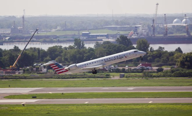 A plane takes off from Philadelphia International Airport, located near the Delaware River.