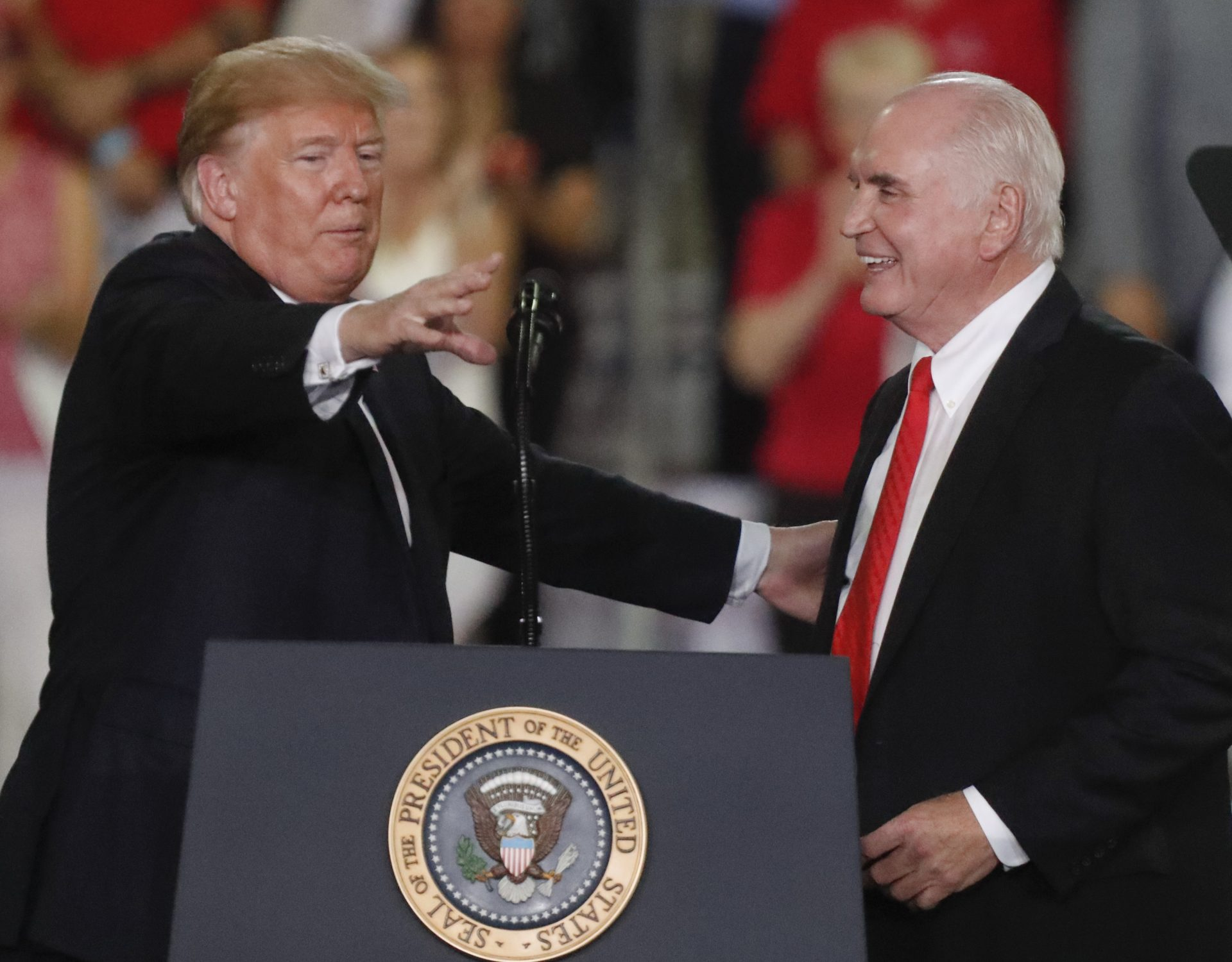 FILE PHOTO: President Donald Trump, left introduces U.S. Congressman Mike Kelly at a rally endorsing the Republican ticket in Pennsylvania on Wednesday, Oct. 10, 2018 in Erie, Pa.