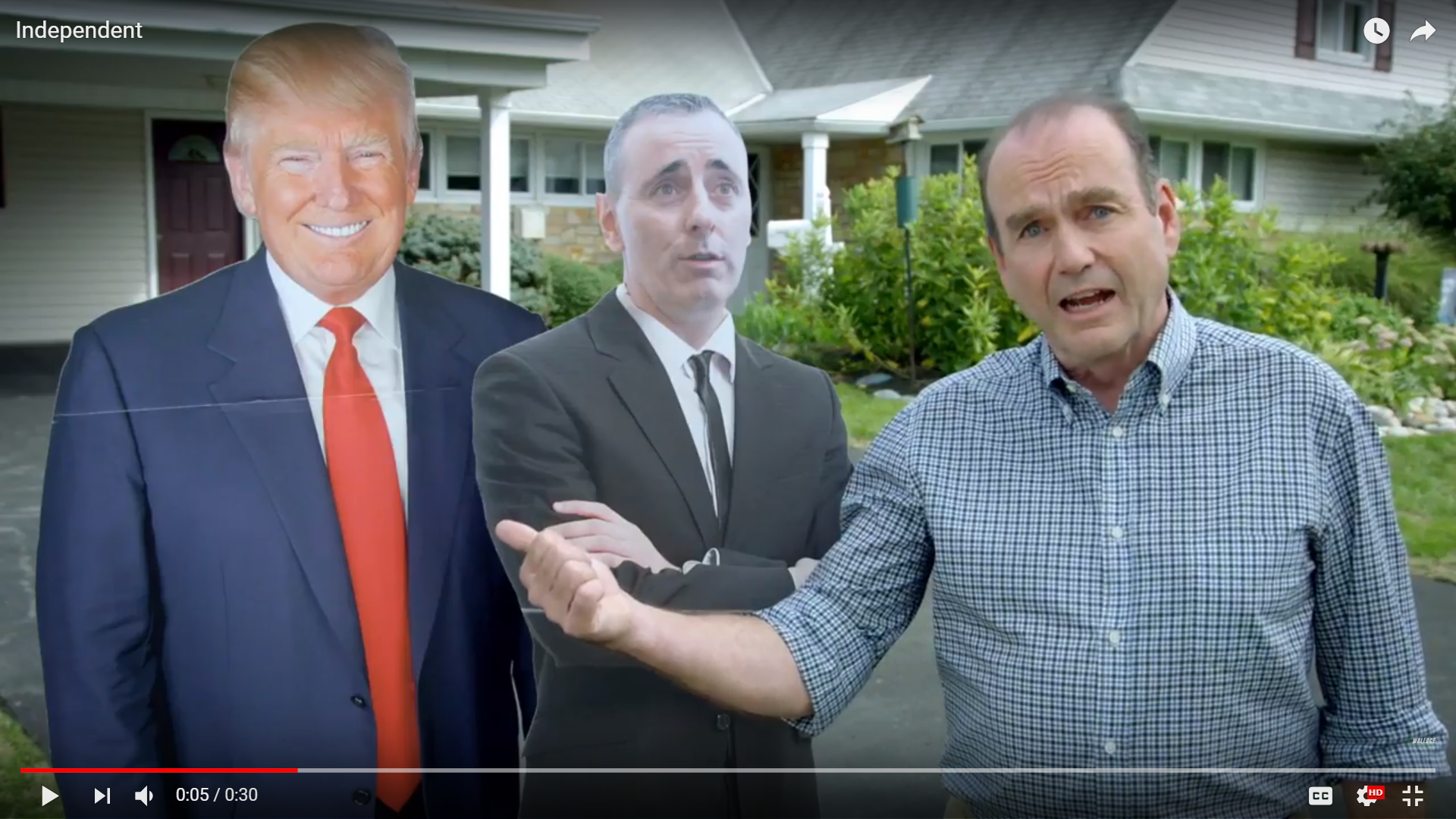 In this campaign ad, Democratic candidate for Congress Scott Wallace stands next to cutouts of Republican President Donald Trump and Republican Congressman Brian Fitzpatrick.