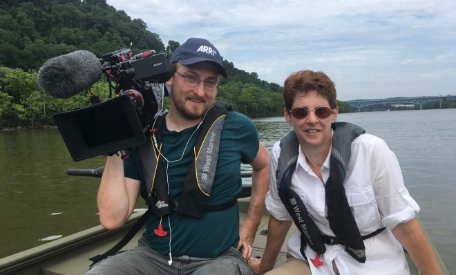"Gina Catanzarite, writer and producer, and Glenn Syska, director of photography and editor, on the ""set"" of their documentary, ""Downstream."""