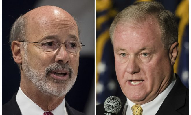 FILE PHOTO:  This combination of October 2017 file photos shows Pennsylvania gubernatorial candidates Democrat Gov. Tom Wolf, left, and Republican Scott Wagner.