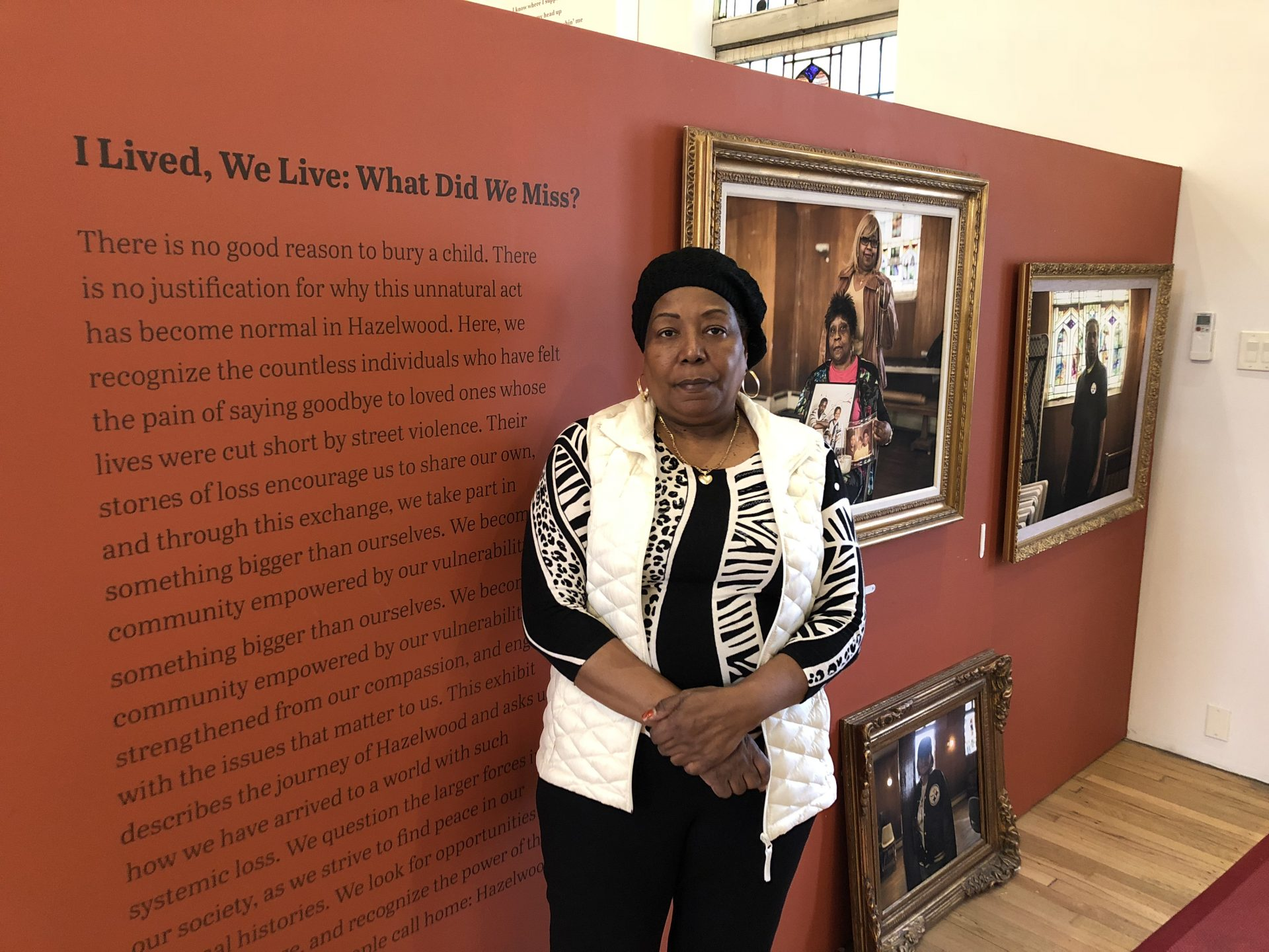 "Geraldine Massey stands in front of the ""I Lived, We Live: What Did We Miss?"" gun-violence exhibit at the Center of Life in the Hazelwood neighborhood of Pittsburgh. A version of the exhibit will be shown at the Jewish Community Center of Greater Pittsburgh."