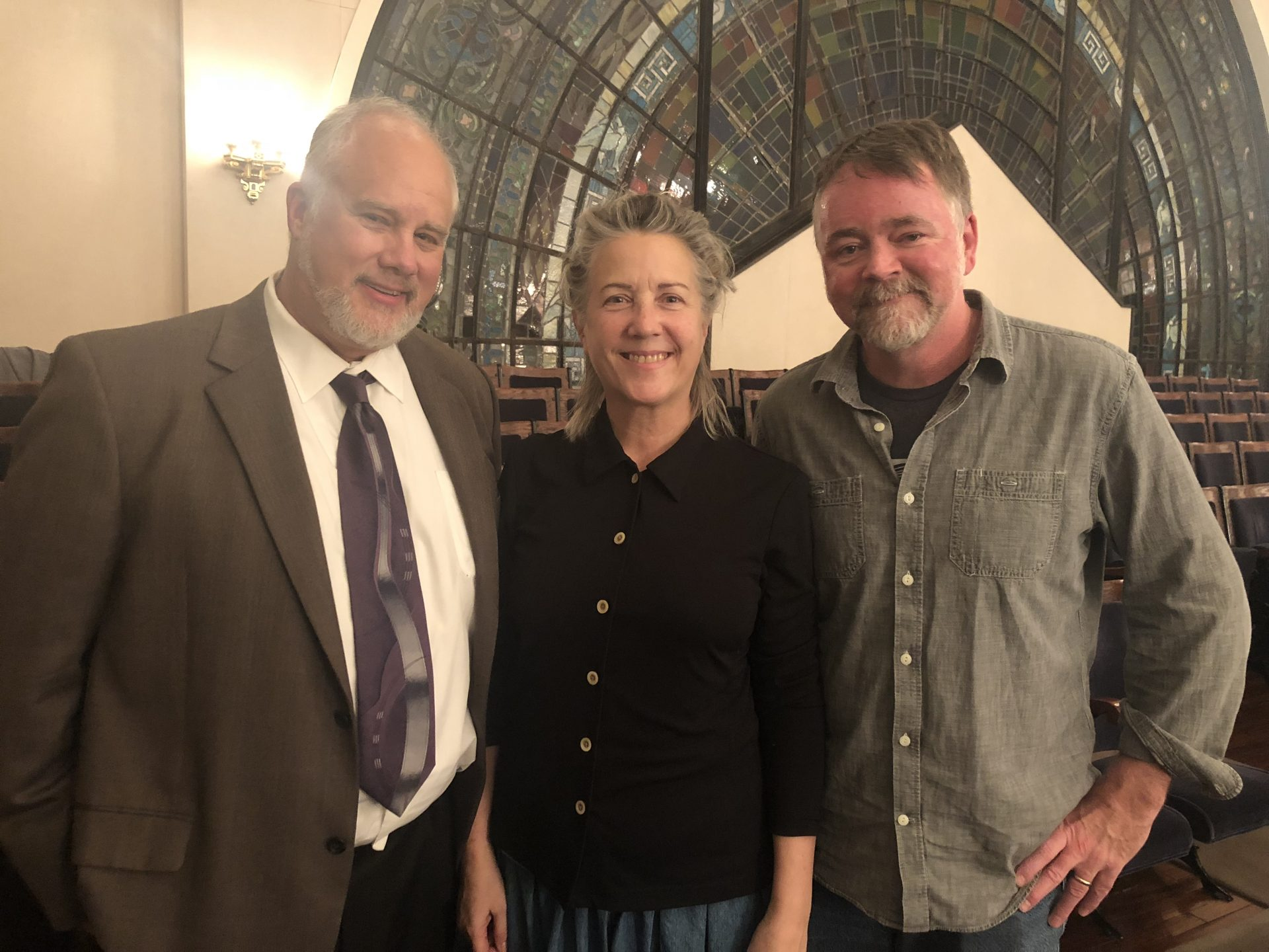 From left to right, Tom Cox, Jean Cox, and Pastor Jeff Eddings, are seen inside Rodef Shalom Congregation in Pittsburgh. They attended services Friday evening to show solidarity with the Jewish community.