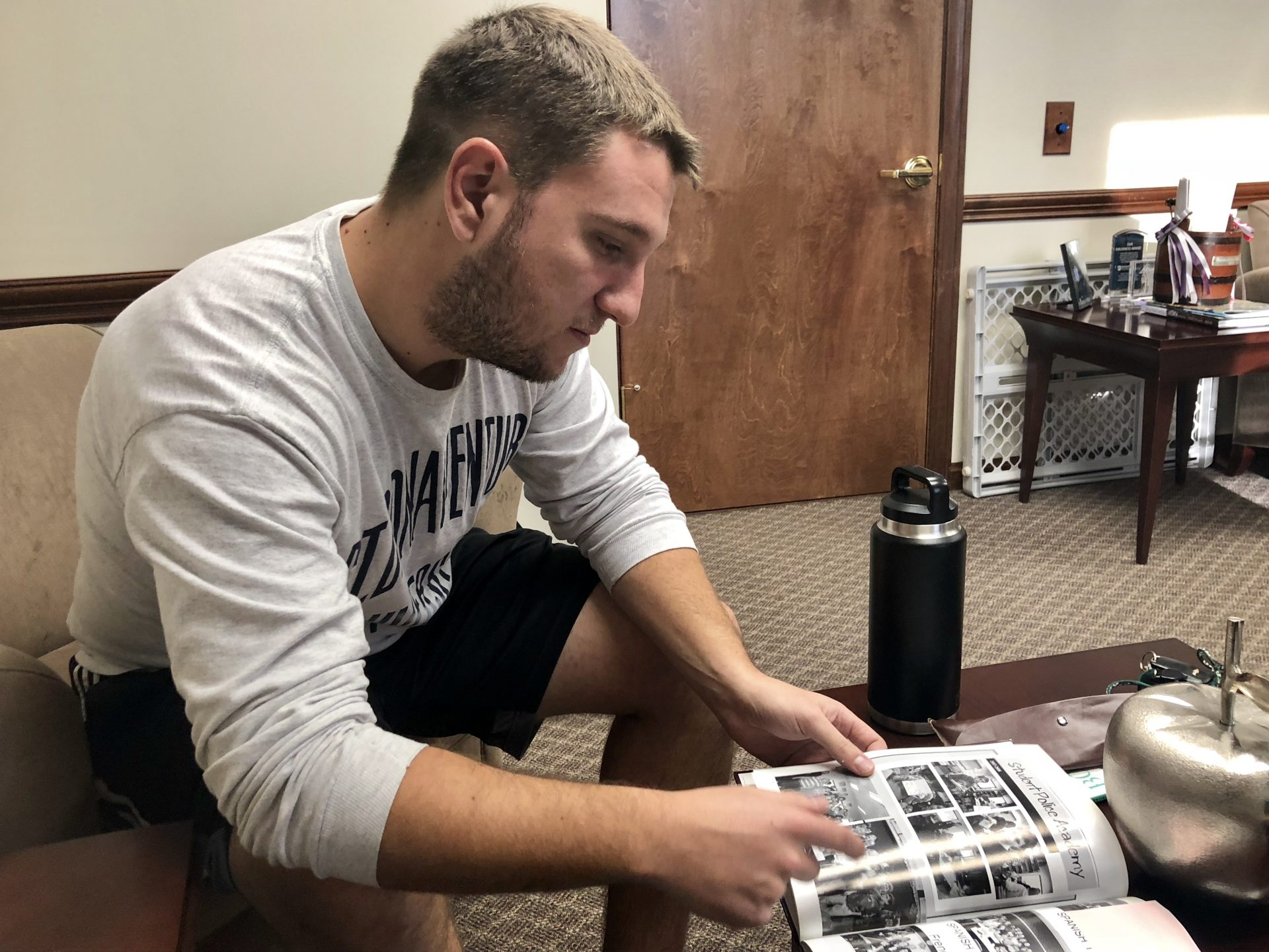 Grant Mundy, who went to school with Dylan Elchin, looks at old yearbooks photos in a Beaver Area School District office on Dec. 13, 2018.