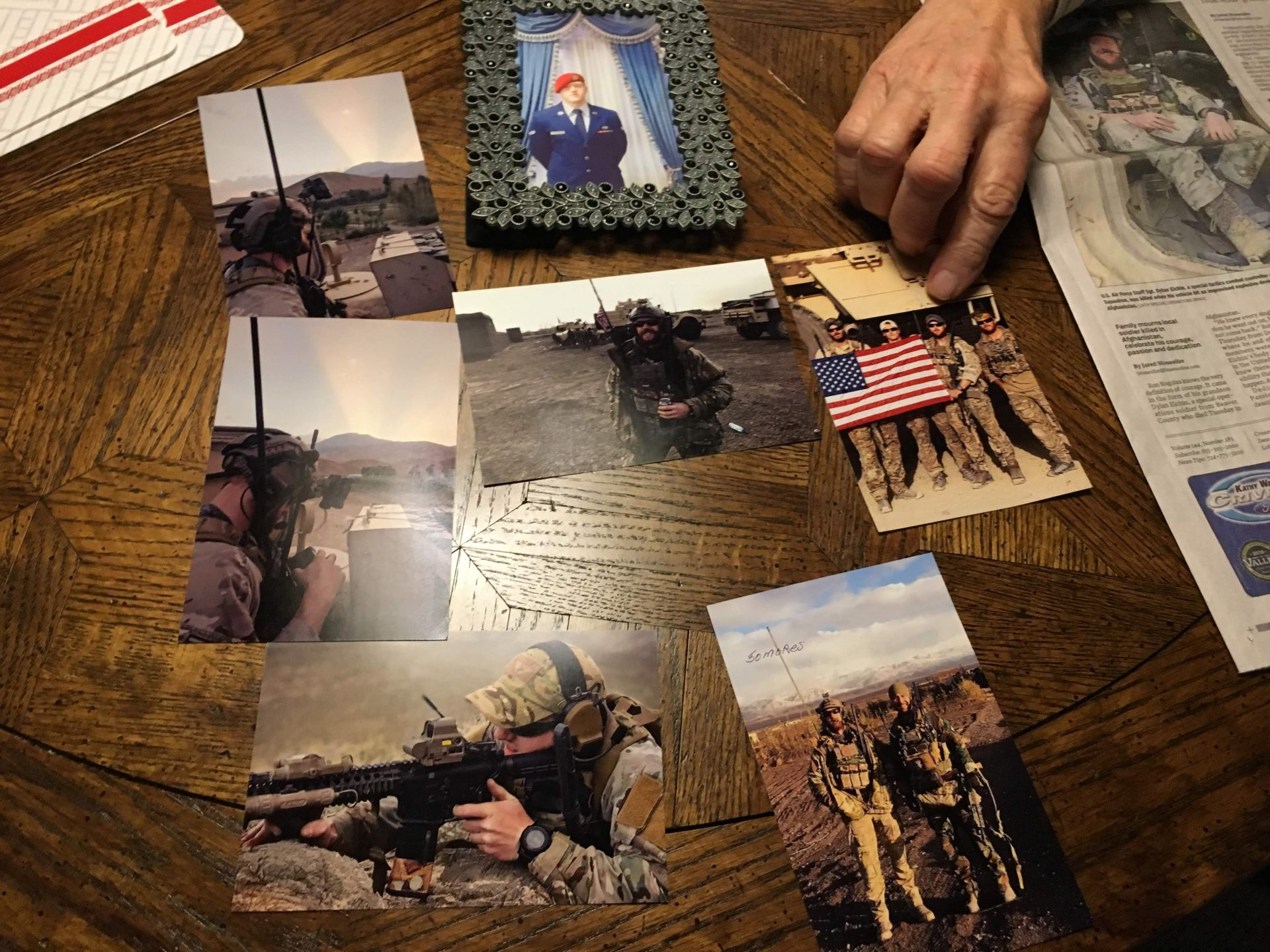 Photos of Air Force Staff Sgt. Dylan Elchin are seen on a table in the home of Ron Bogolea, Elchin's maternal grandfather, on Thursday, Dec. 13, 2018.