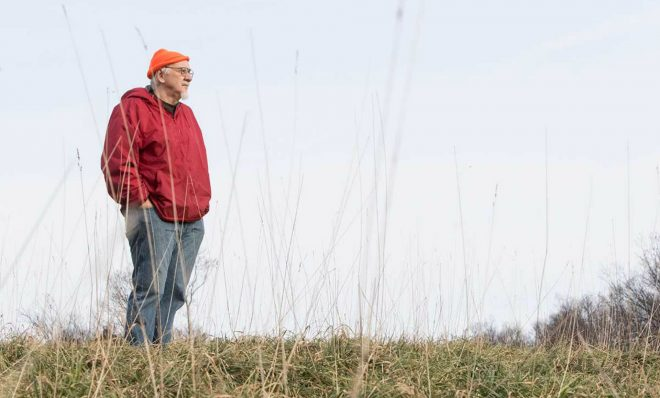 David Wentz looks out from a hill on his land. Wentz sued EQT Corp. for building natural gas wells there.