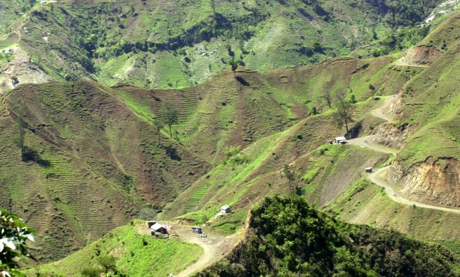 FILE PHOTO: The denuded slopes of Massif de la Selle mountain range in Haiti above Jacmel, are seen Thursday June 5, 2003. Once covered with pine, cedar and juniper trees, the slopes are on their way to complete deforestation as farmers cut down trees and plant vegetables in the fragile topsoil.
