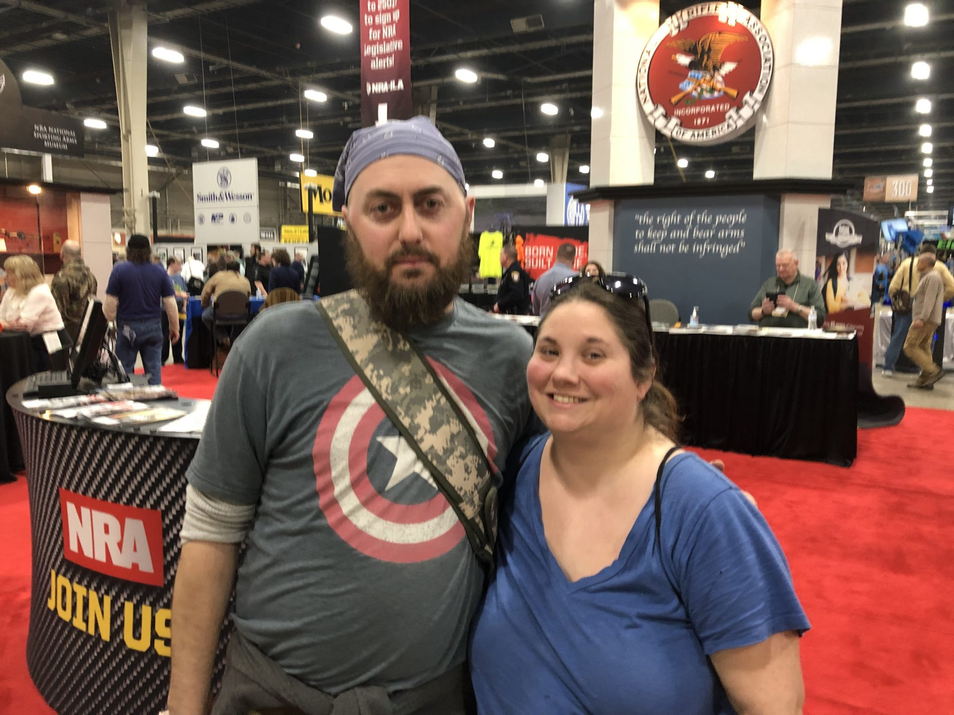 D. Fischer and his wife, Andrea Brown, are seen at an NRA both at the Great American Outdoor Show on Feb. 7, 2019.