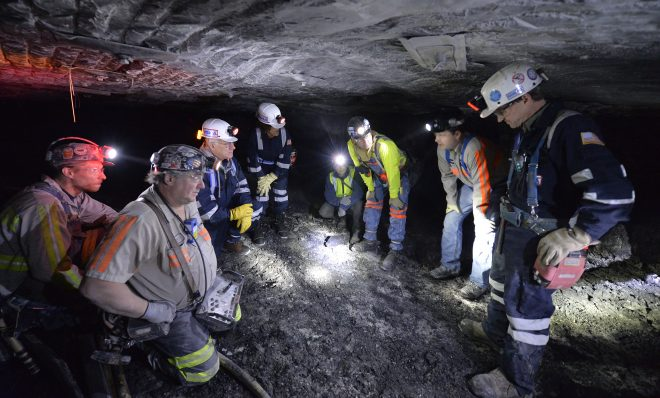In this photo, from 2015 Joe Main, third from left, Assistant Secretary of Labor for Mine Safety and Health, and Patricia Silvey, center, Deputy Assistant Secretary for Operations with MSHA, speak with workers at the Gibson North mine, in Princeton, Ind. Federal mining regulators in December 2017 indicated they were reconsidering rules meant to protect underground miners from breathing coal and rock dust - the cause of black lung - and diesel exhaust, which can cause cancer.