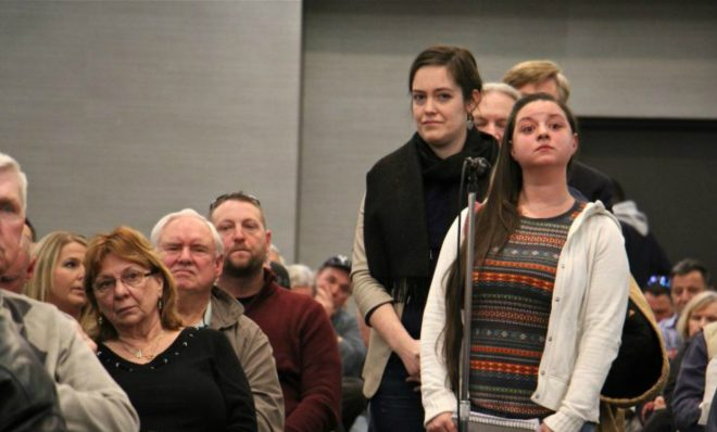 Amanda Vendetti of Tullytown and other Lower Bucks County residents line up to ask questions of DEP officials about a toxic waste recycling and storage facility proposed for Falls Township, Pa.