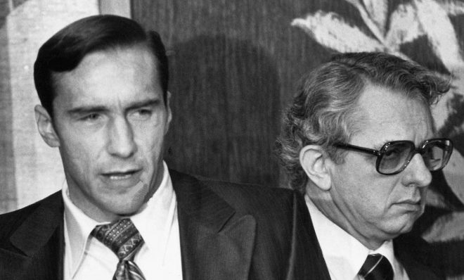 Walter Creitz, right, president of Metropolitan Edison Company, turns away as company Vice President John Herbein answers questions at a news conference in Hershey, Pa., on March 29, 1979. The conference was held because of an accident that occured at the company's Three Mile Island nuclear power plant near Harrisburg, Pa., that caused radiation leakage into the atmosphere.