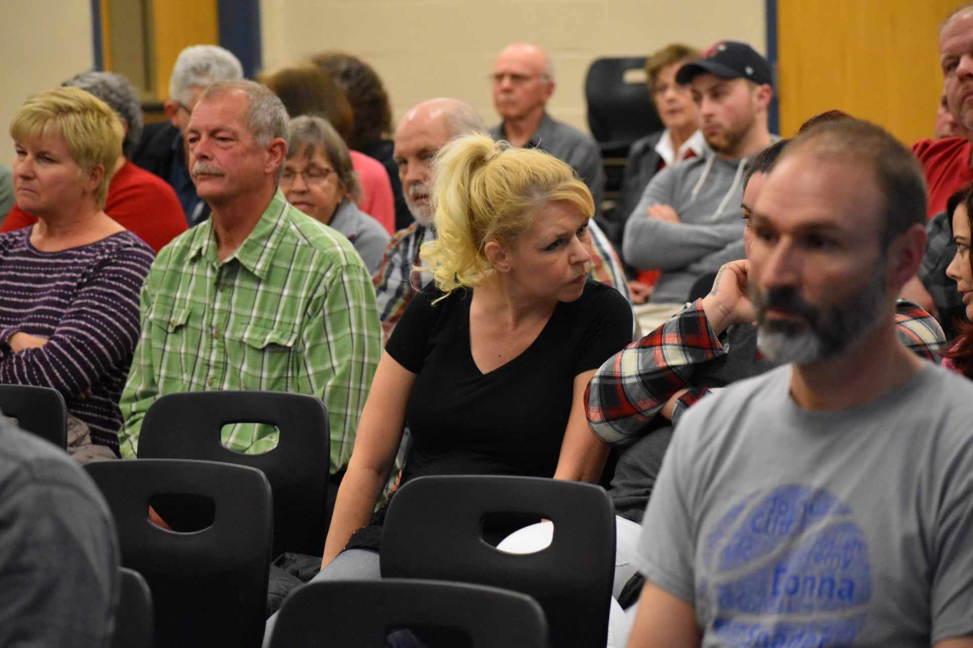 Hope Adkins-Durante, in the black shirt, listens to another community member during a meeting on March 14, 2019, in the Eastern Lancaster County School District.