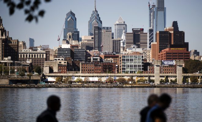 The Philadelphia skyline is seen along the banks of the Delaware River.