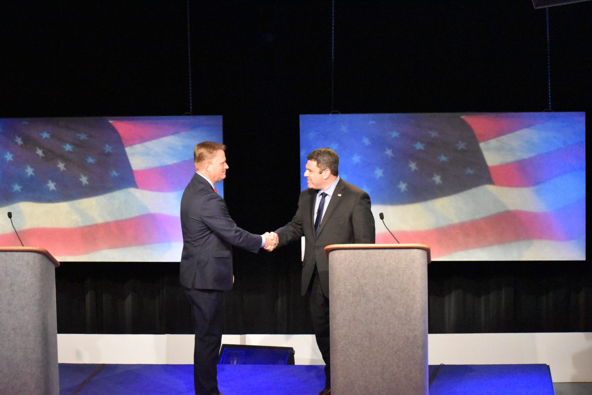 Republican Fred Keller, left, shakes hands with Democrat Marc Friedenberg ahead of a debate for Pennsylvania's 12th congressional district on May 2, 2019.