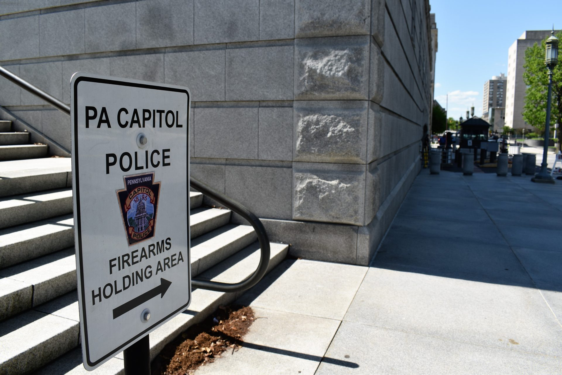 A sign outside the state Capitol directs people to a firearms holding area on May 6, 2019.