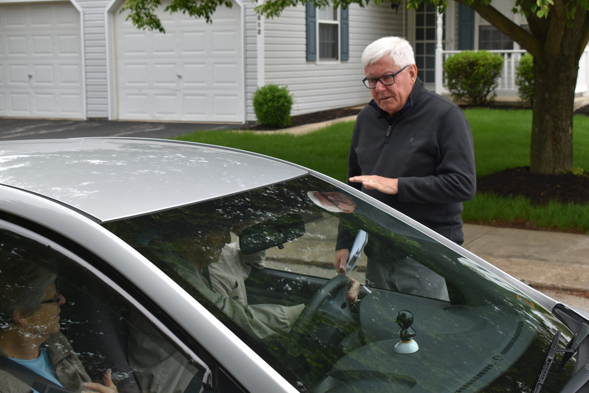 Republican Steve Chronister talks to voters in their car on May 8, 2019, while campaigning for York County commissioner.