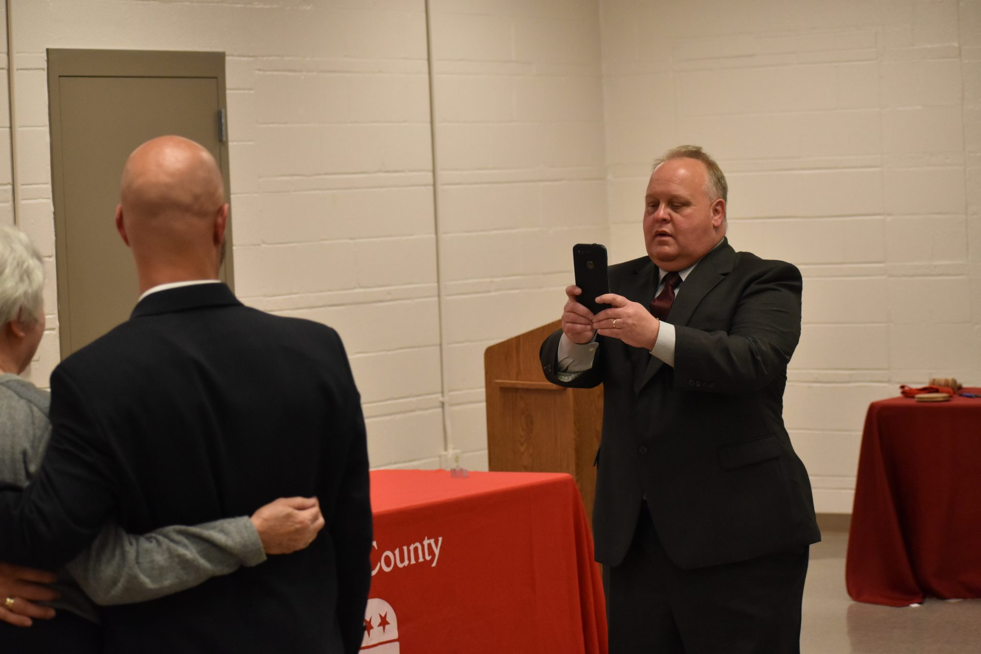 Republican commissioner candidate Ron Smith takes a picture for people who attended a debate on April 29, 2019, at Shiloh Fire Company in York County.