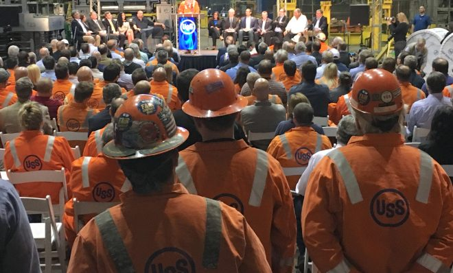 Steelworkers watch Thursday as U.S. Steel president and CEO David Burritt announces a $1-billion investment in upgrades at Clairton Coke Works and the Edgar Thomson plant near Pittsburgh.
