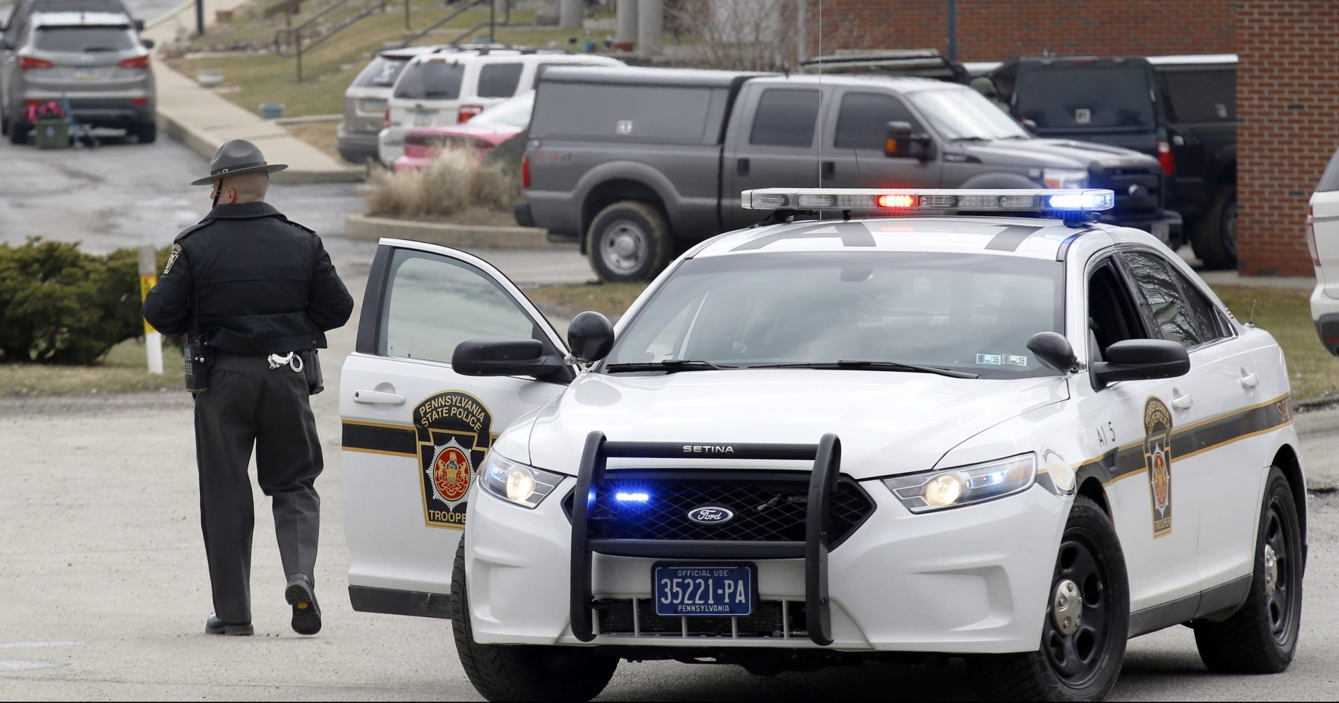 In this March 27, 2015 file photo, Pennsylvania State Police block the road to an apartment complex in Hempfield, Pa.