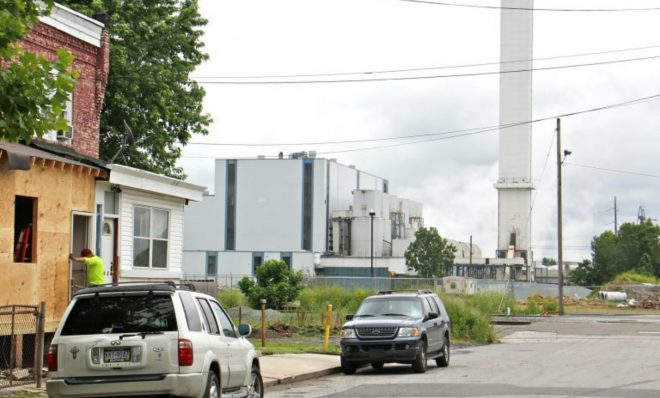 The smokestack of the Delaware Valley Resource Recovery Facility looms over a residential street in Chester.