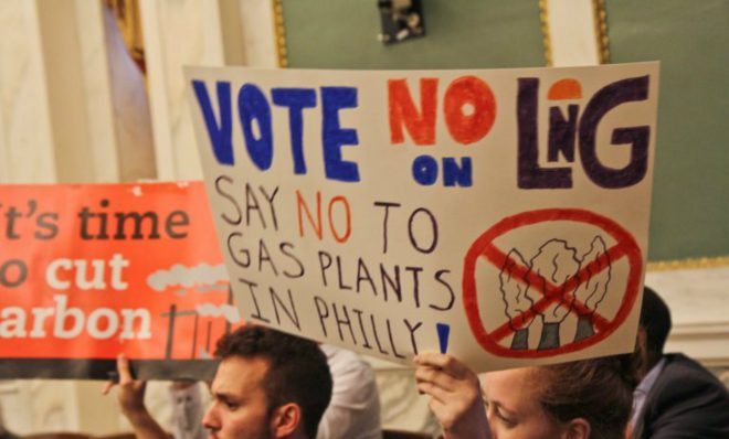 Opposition to the proposed liquefied natural gas plant in Philadelphia protest in city council chambers Thursday.