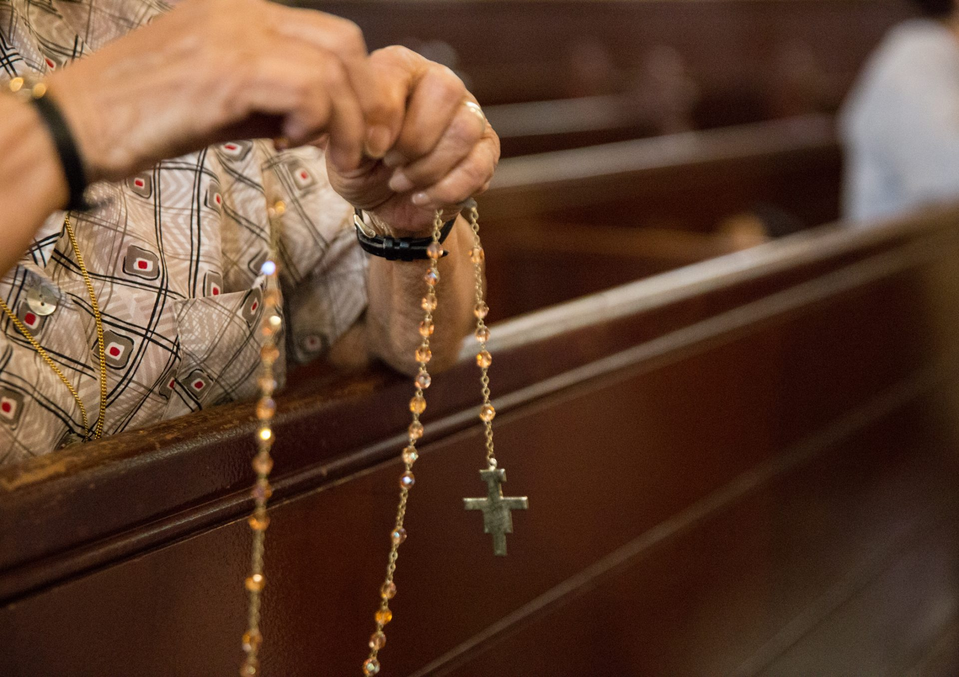 Parishioners pray the Rosary at Holy Infancy Roman Catholic Church in Bethlehem, Pennsylvania after mass on Tuesday, August 14, 2018. The same day, Pennsylvania Attorney General released his two-year grand jury investigation into widespread sexual abuse and cover-up within six Catholic dioceses across the state.