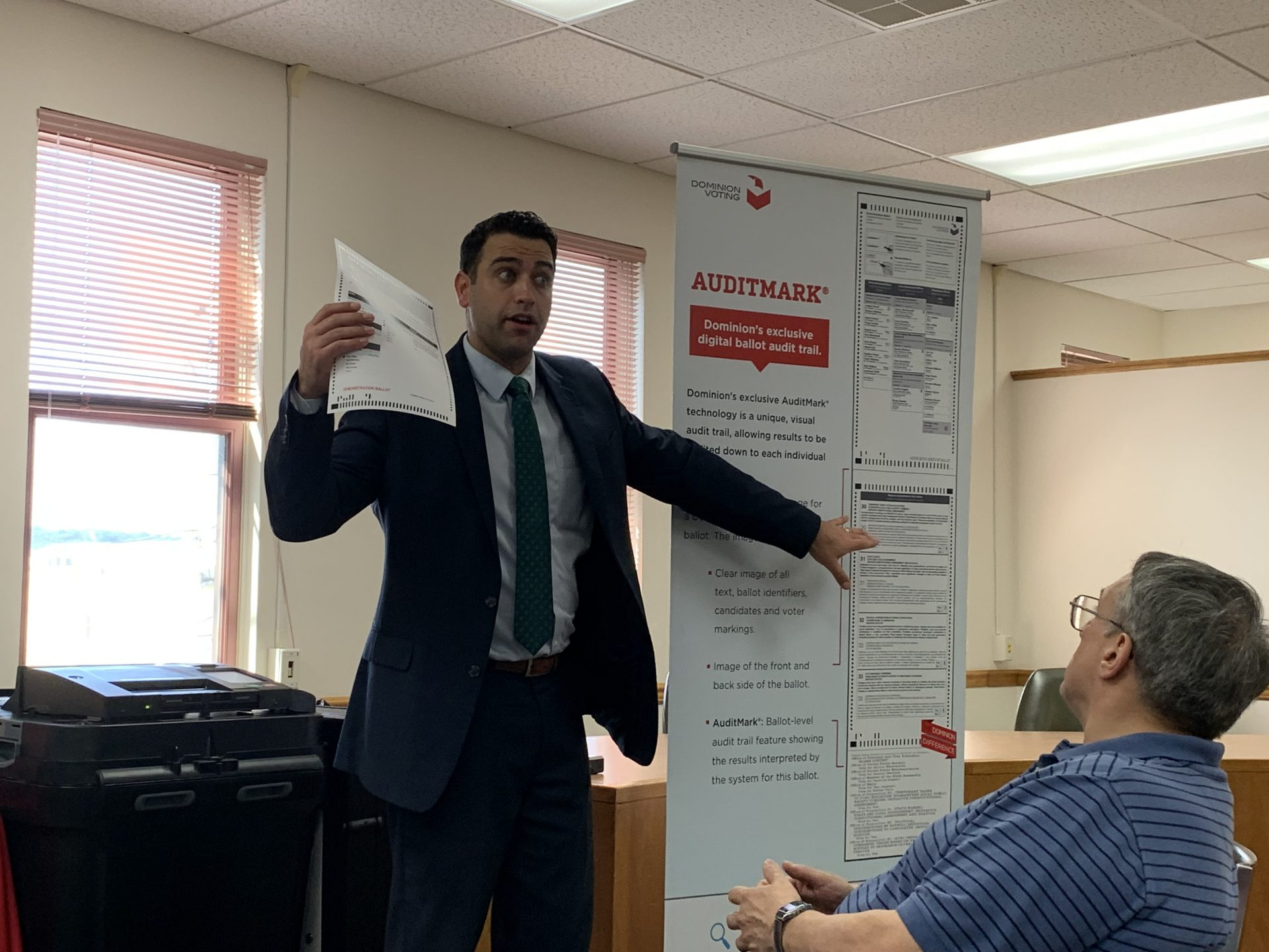 John Hastings, regional sales manager with Dominion Voting Systems, explains how the company's auditing system works to officials in Columbia County June 26, 2019. (Emily Previti, PA Post)