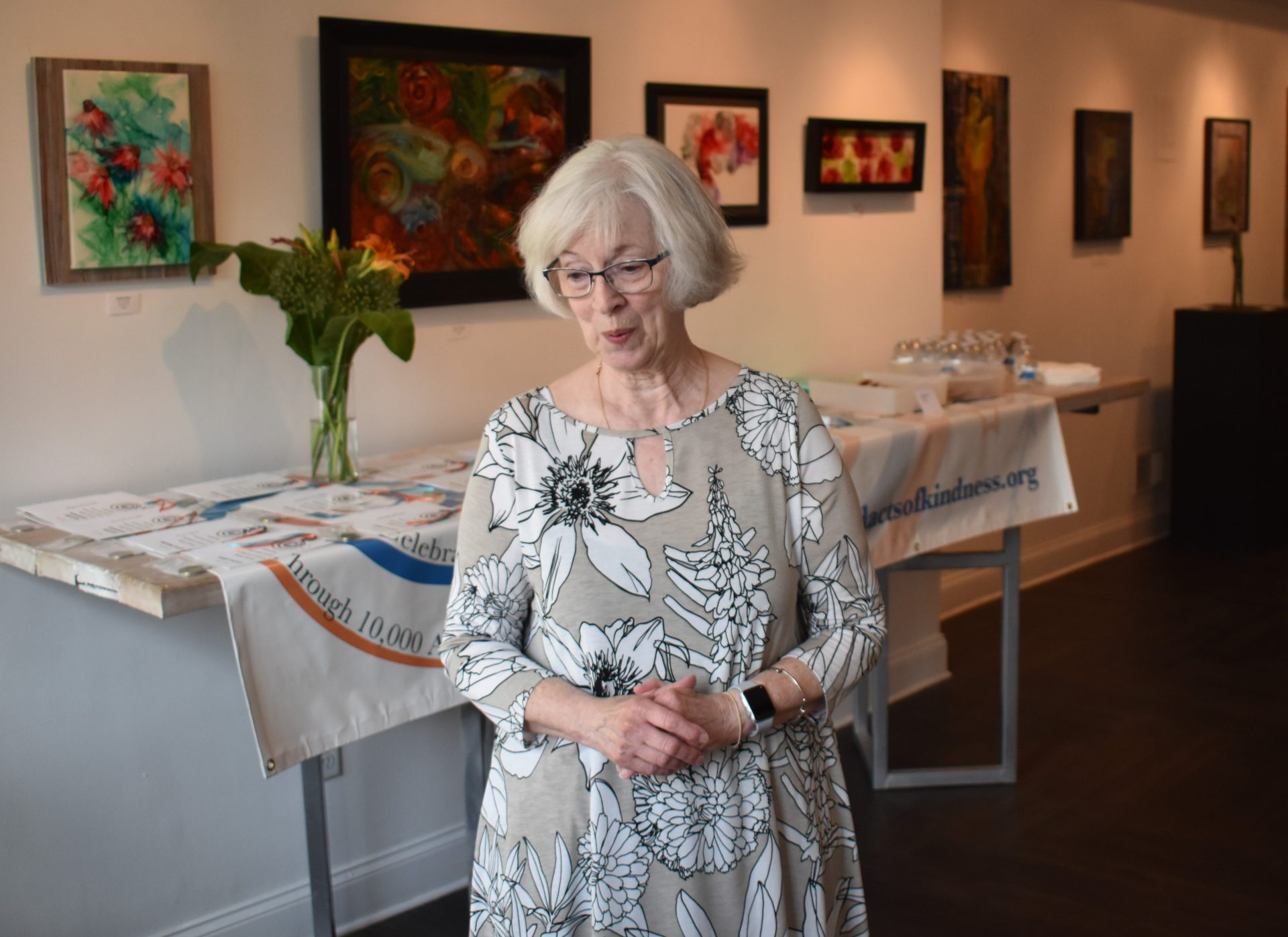 Mary Jo Fero, a member of the communications committee for 10,000 Acts of Kindness, greets people for a poetry awards contest ceremony on June 12, 2019, at The Parliament Arts Organization in York.